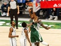Milwaukee Bucks forward Giannis Antetokounmpo dunks against Brooklyn Nets guard Kyrie Irving on May 2, 2021
