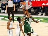 Milwaukee Bucks forward Giannis Antetokounmpo dunks against Brooklyn Nets guard Kyrie Irving on May 2, 2021