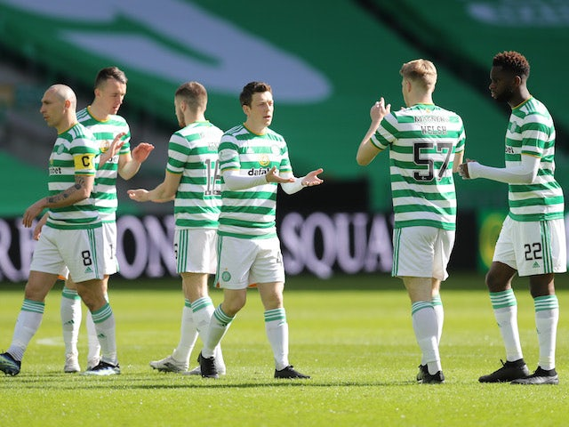 Celtic's Callum McGregor with teammates before the match in March 2021