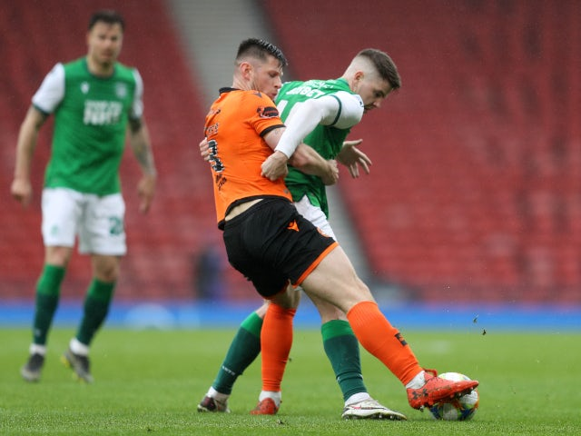 Dundee United's Calum Butcher in action with Hibernian's Kevin Nisbet in the Scottish FA Cup on May 8, 2021