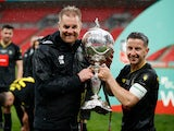 Harrogate Town's Josh Falkingham and manager Simon Weaver celebrate with the trophy after winning the FA Trophy Final on May 3, 2021