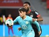 Wolfsburg's Josip Brekalo in action with Bayer Leverkusen's Timothy Fosu-Mensah in January 2021