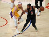 LA Clippers guard Paul George handles the ball while defended by Los Angeles Lakers guard Alex Caruso on May 7, 2021