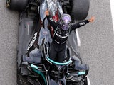 Mercedes driver Lewis Hamilton celebrates winning the Spanish Grand Prix on May 9, 2021