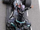 Mercedes driver Lewis Hamilton celebrates winning the Spanish Grand Prix on May 9, 2021