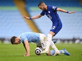 Manchester City's Ruben Dias in action with Chelsea's Hakim Ziyech in the Premier League on May 8, 2021