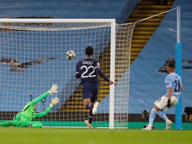 Manchester City's Riyad Mahrez scores their second goal against Paris Saint-Germain in the Champions League on May 4, 2021