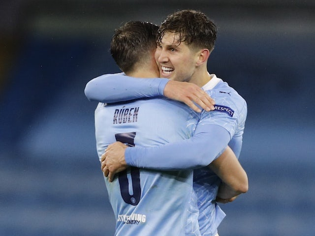 Manchester City's Ruben Dias and John Stones celebrate after the match on May 4, 2021