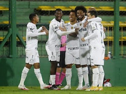 Palmeiras' Rony celebrates scoring their first goal with teammates on May 4, 2021