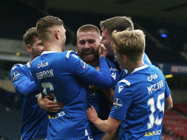 St Johnstone's Shaun Rooney celebrates scoring their first goal with teammates in February 2021