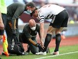 Manchester United's Harry Maguire goes off injured against Aston Villa in the Premier League on May 9, 2021