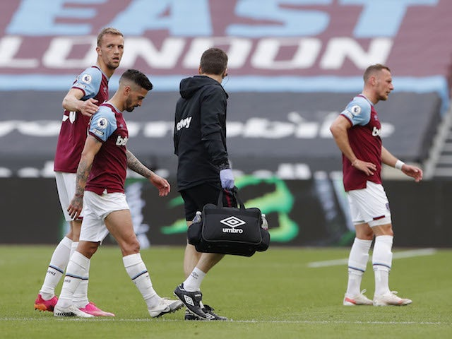 West Ham United's Manuel Lanzini receives medical attention after sustaining an injury on May 9, 2021
