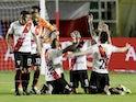 Always Ready's Fernando Saucedo celebrates scoring their first goal with teammates in April 2021