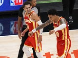 Atlanta Hawks forward John Collins and guard Trae Young pictured on May 12, 2021