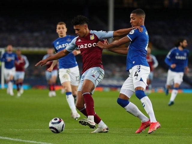 Aston Villa's Ollie Watkins in action with Everton's Mason Holgate