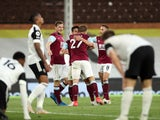 Fulham players look dejected as Burnley's Ashley Westwood celebrates scoring their first goal  in the Premier League on May 10, 2021