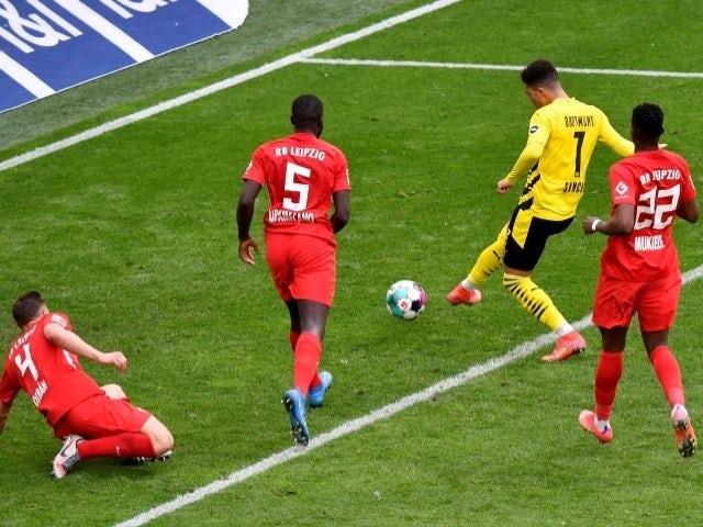 Borussia Dortmund's Jadon Sancho scores their third goal against RB Leipzig on 8 May, 2021