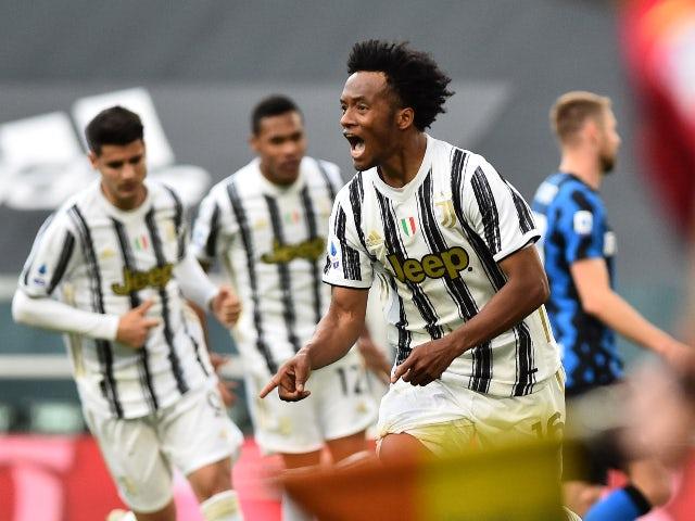 Juventus' Juan Cuadrado celebrates scoring their third goal against Inter Milan in Serie A on May 15, 2021