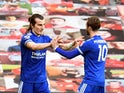 Leicester City's Caglar Soyuncu celebrates scoring their second goal with James Maddison against Manchester United in the Premier League on May 11, 2021