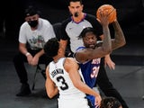 New York Knicks' Julius Randle protects the ball from San Antonio Spurs' Keldon Johnson on May 14, 2021