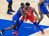 Philadelphia 76ers center Joel Embiid drives against Orlando Magic guard Dwayne Bacon on May 15, 2021