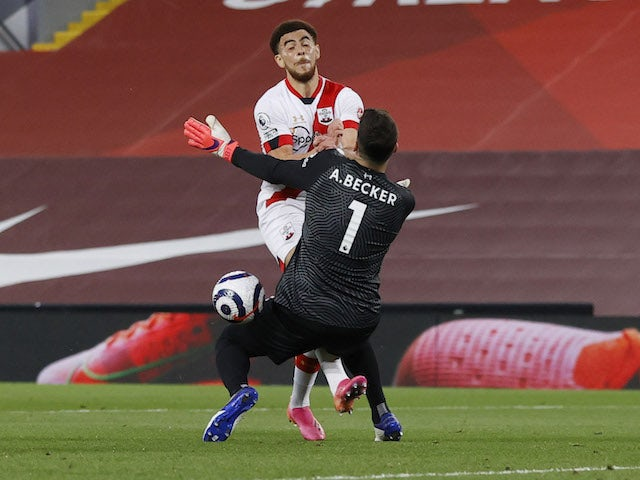 Southampton's Che Adams in action with Liverpool's Alisson on May 8, 2021