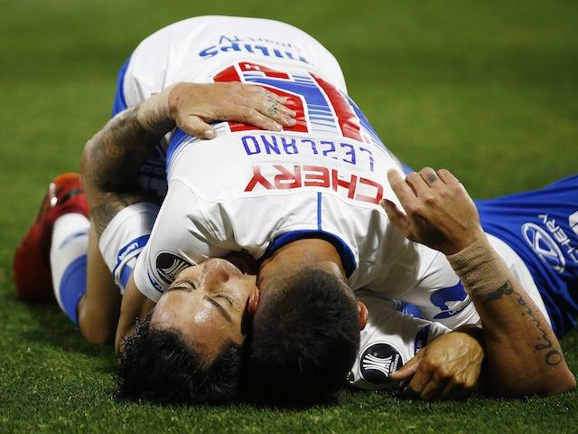 Universidad Catolica's Fernando Zampedri celebrates scoring their second goal with Gaston Lezcano in October 2020