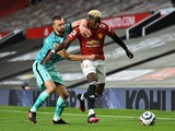 Manchester United's Paul Pogba in action with Liverpool's Nat Phillips in the Premier League on May 13, 2021