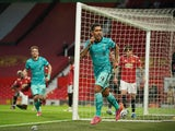 Liverpool's Roberto Firmino celebrates scoring against Manchester United in the Premier League on May 13, 2021