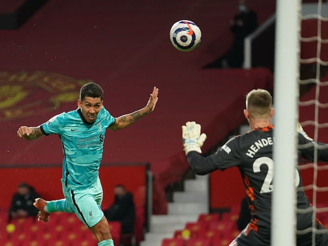 Liverpool's Roberto Firmino scores against Manchester United in the Premier League on May 13, 2021