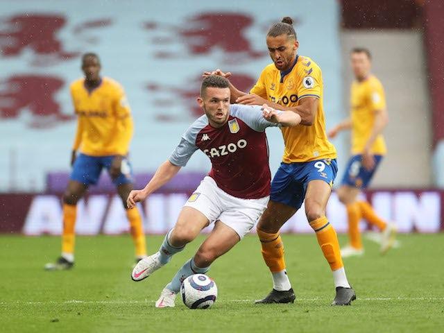 Aston Villa's John McGinn in action with Everton's Dominic Calvert-Lewin in the Premier League on May 13, 2021