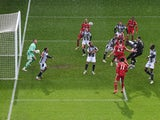 Liverpool goalkeeper Alisson Becker scores against West Bromwich Albion in the Premier League on May 16, 2021