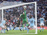 Ben Watson scores Wigan's first goal against Manchester City in the FA Cup final on May 11, 2013