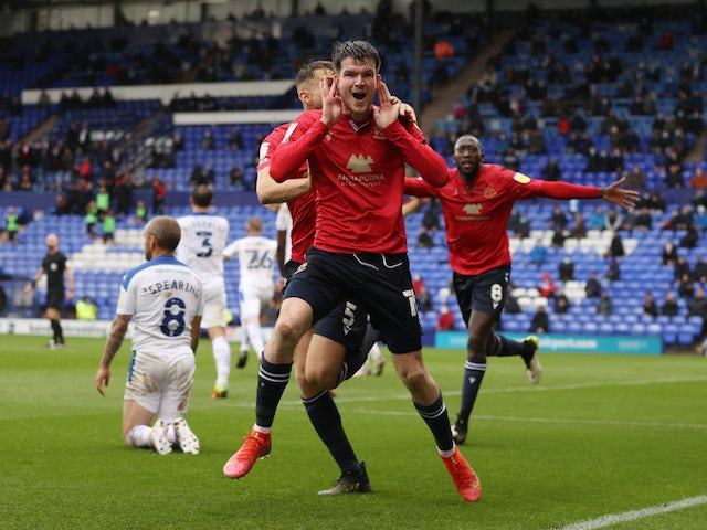 Morecambe's Liam McAlinden celebrates scoring against Tranmere Rovers on May 20, 2021