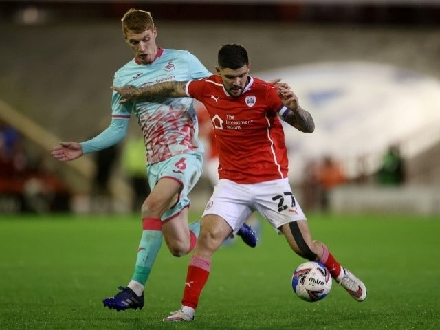 Barnsley's Alex Mowatt takes on Swansea City's Jay Fulton on May 17, 2021