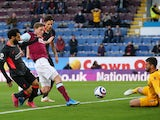 Burnley's Chris Wood shoots at goal against Liverpool in the Premier League on May 19, 2021