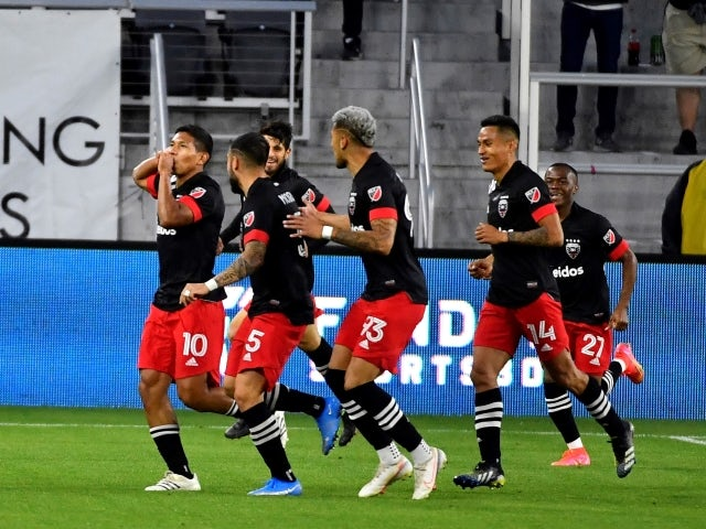 DC United forward Edison Flores celebrates after scoring a goal against the Chicago Fire on May 13, 2021