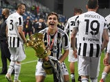 Juventus' Federico Chiesa celebrates with the Coppa Italia trophy on May 19, 2021