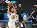 Golden State Warriors guard Stephen Curry shoots the basketball against Memphis Grizzlies guard Ja Morant on May 16, 2021