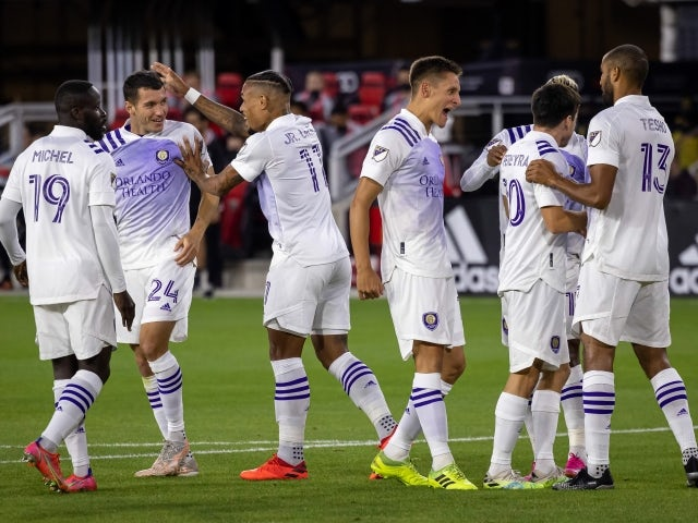 Orlando City midfielder Mauricio Pereyra celebrates with teammates after scoring a goal against D.C. United on May 16, 2021