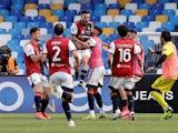 Cagliari's Nahitan Nandez celebrates scoring their first goal with teammates on May 2, 2021