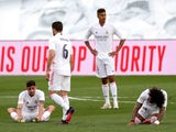 Real Madrid players look dejected after Atletico Madrid win the La Liga title on May 22, 2021