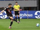 Bayern Munich's Robert Lewandowski scores their first goal from the penalty spot on May 15