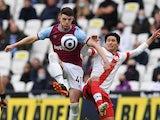 West Ham United's Declan Rice in action with Southampton's Takumi Minamino in the Premier League on May 23, 2021