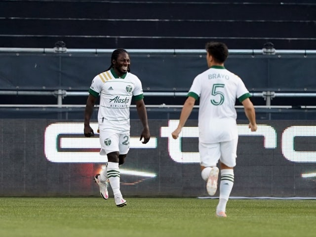 Portland Timbers forward Yimmi Chara celebrates with defender Claudio Bravo after scoring a goal on 15 May, 2021