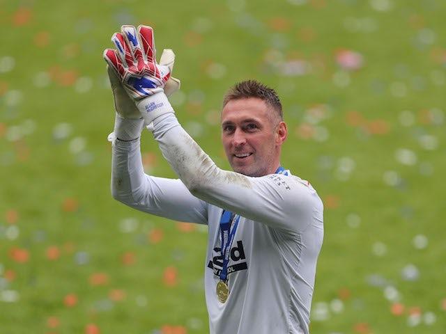 Rangers' Allan McGregor applauds as he celebrates winning the Scottish Premiership on May 15, 2021
