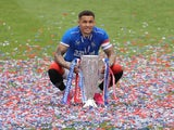 Rangers' James Tavernier poses with the trophy as he celebrates winning the Scottish Premiership on May 15, 2021