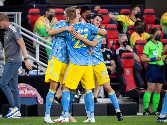Philadelphia Union forward Kacper Przybylko celebrates with teammates after a replay review credits him with a goal on May 23, 2021