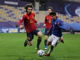Spain Under-21s' Marc Cucurella in action with Italy Under-21s' Raoul Bellanova on March 27, 2021