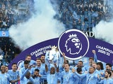 Manchester City players lift the Premier League trophy on May 23, 2021